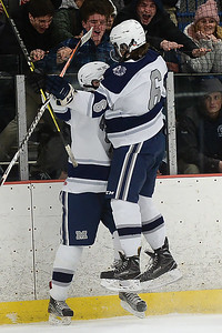 #6, Aidan Tolnai congratulates #17, Ryan Scott of the Manasquan High School Boy's Varsity Ice Hockey Team after his Second Period Goal scored against Wall Township High School at the Jersey Shore Arena on 01/30/2019. (STEVE WEXLER/THE COAST STAR).