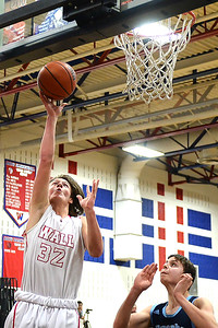 #32, Logan Peters of the Wall Crimson Knights Boy's Varsity Basketball Team lays the ball up for two points against Mater Dei High School in their game played at Wall High School gymnasium, Wall, NJ on 02/13/2019. (STEVE WEXLER/THE COAST STAR).