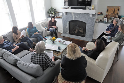 Vice President and co-founder of Impact 100 Jersey Coast Heather Burke (top center) speaks during a membership drive for Impact 100 Jersey Coast that was held at the home of Holly Deitz in Belmar on Wednesday Feb. 13, 2019. (MARK R. SULLIVAN/THE COAST STAR)