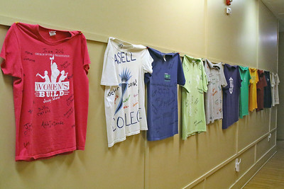 Tee shirts along with a map with pins represents each state or country in which a volunteer is from that has spend time volunteering at Info Age in Wall Township. (MARK R. SULLIVAN /THE COAST STAR)