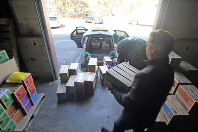 Volunteers help load boxes of Girl Scout cookies into waiting vehicles to be delivered to local Girl Scout troops from a warehouse in Wall Township on Tuesday Feb. 19, 2019 (MARK R. SULLIVAN /THE COAST STAR)