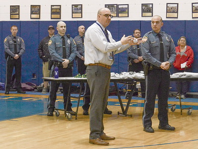 [center left] s.l.h.e.s. principal speaking about the dare program and officer hagar's [center right] influence on the kids