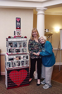 SUNRISE _ Deb Killeen who created the tower pictured with Zabelle one of the residents