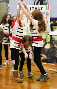 [L-R] Izzy Daniel, Lexi Drent, and Mia Bramley. The Girl Scouts of Brielle, Manasquan, Spring Lake, and Spring Lake Heights participating in World Day at Brielle Elementary School in Brielle, NJ on 2/27/19. [DANIELLA HEMINGHAUS | THE COAST STAR]