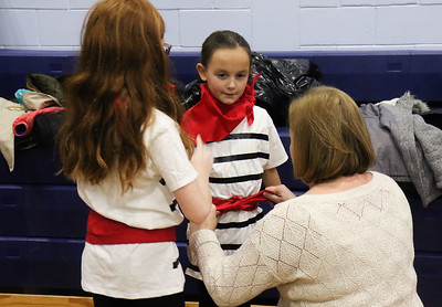 Mia Bramley and Julianna Bramley fixing Izzie Daniel's Italian outfit. The Girl Scouts of Brielle, Manasquan, Spring Lake, and Spring Lake Heights participating in World Day at Brielle Elementary School in Brielle, NJ on 2/27/19. [DANIELLA HEMINGHAUS | THE COAST STAR]