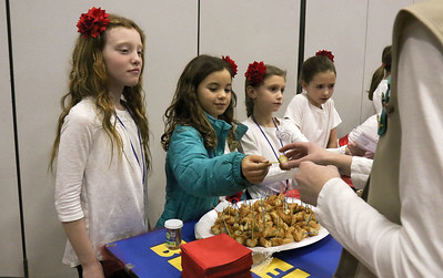(in center) Catherine Giunco handing out churros. The Girl Scouts of Brielle, Manasquan, Spring Lake, and Spring Lake Heights participating in World Day at Brielle Elementary School in Brielle, NJ on 2/27/19. [DANIELLA HEMINGHAUS | THE COAST STAR]