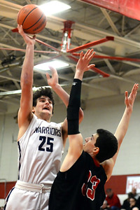 #25, Alex Galvan of the Manasquan Warriors Boy's Varsity Basketball Team, takes a shot over a Haddonfield High School defender in Manasquan High School's Group 2 Semi-Final game played at Perth Amboy High School on 03/06/2019. (STEVE WEXLER/THE COAST STAR).