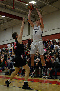 #3, Brad McCabe of the Manasquan High School Boy's Varsity Basketball Team takes a high corner three point shot over the outstretched arm of a Haddonfield High School defender in their NJSIAA Group 2 Semi-Final game played at Perth Amboy High School gymnasium on 03/06/2019. (STEVE WEXLER/COAST STAR).