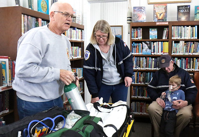 "[L-R]: John O'Grady, Karen, Tom, and Will Crawley. Manasquan First Aid Squad visiting Sea Girt library to teach the children about what they do as a part of the library's ""People In Our Neighborhood"" series. [DANIELLA HEMINGHAUS 