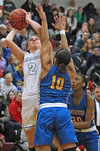 Lola Mullaney (left) fights her way around Kemari Reynolds as Manasquan High School takes on Manchester High School during the NJSIAA Girls Group 3 semifinal held at Central Regional High School in Berkeley Township on Thursday March 7, 2019. (MARK R. SULLIVAN /THE COAST STAR)