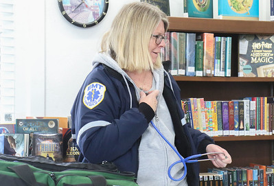 "Karen Crawley showing how a stethoscope works. Manasquan First Aid Squad visiting Sea Girt library to teach the children about what they do as a part of the library's ""People In Our Neighborhood"" series. [DANIELLA HEMINGHAUS 