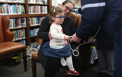 "Lucy Garagano with her mom, Julia, getting her pulse-ox read. Manasquan First Aid Squad visiting Sea Girt library to teach the children about what they do as a part of the library's ""People In Our Neighborhood"" series. [DANIELLA HEMINGHAUS 