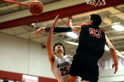 The Manasquan High School Boy's Varsity Basketball Team took on a formiddable Haddonfield High School defense in their NJSIAA Group 2 Semi-Final game palyed at Perth Amboy High School. #25, Alex Galvan is seen having his close in shot blocked by a Haddonfield defender early in the first quarter of the game on 03/06/2019. (STEEV WEXLER/THE COAST STAR).