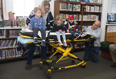 "[L-R]: Will Crawley, Evelyn Deantonio, Ethan Hodes. Manasquan First Aid Squad visiting Sea Girt library to teach the children about what they do as a part of the library's ""People In Our Neighborhood"" series. [DANIELLA HEMINGHAUS 