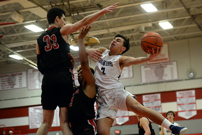 #2, Casey Mulligan of the Manasquan High School Boy's Varsity Basketball Team drives to the basket around Haddonfield High School defenders in their NJSIAA Group 2 Semi-Final game played at Perth Amboy High School on 03/06/2019. (STEVE WEXLER/THE COAST STAR).