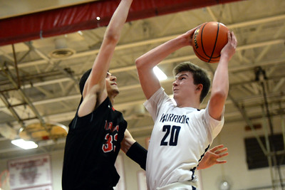 #20, Tim McEneny of the Manasquan High School Boy's Varsity Basketball Team takes a shot over a Haddonfield High School defender in their NJSIAA Group 2 Semi Final game played at Perth Amboy High School on 03/06/2019. (STEVE WEXLER/THE COAST STAR).