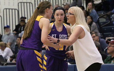 no.10, Abby Antognoli [in center] and no.3, Lauren Lithgow talking to their coach. St. Rose girl's basketball v/s Franklin in Toms River, NJ on3/14/19. [DANIELLA HEMINGHAUS | THE COAST STAR]
