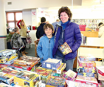 Wall Monmouth County Library Book Sale 03/11/2016 from L to R: Justin Jameson age 9 and Jennifer Jameson from Hopewell