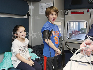 SG Library Ambulence Visit// L to R:Julia Litzinger 6 and Jake Litzinger 8 sea girt got a ride in the ambulence and tested out equipment