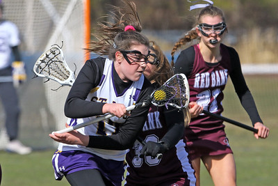 Avery Morgan (left) battles with Red Bank regional defenders as St Rose High School girls varsity lacrosse takes on Red Bank Regional High School on Wednesday March 27, 2019 at the St Rose Sports Complex in Wall. (MARK R. SULLIVAN /THE COAST STAR)