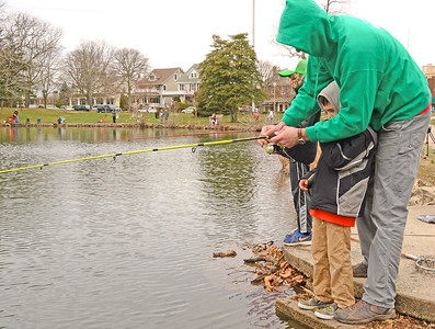 Joe Accurso, from sea girt, teaching his son Andy how to fish. The annual trout contest in Spring Lake on 4/7/18. (DANIELLA HEMINGHAUS | THE COAST STAR).