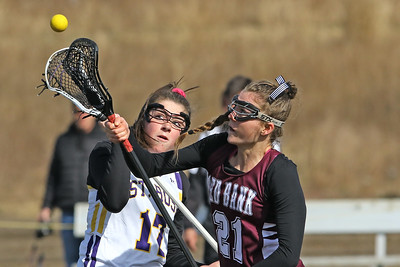 Avery Morgan (left) battles with Meghan Murray (right) as St Rose High School girls varsity lacrosse takes on Red Bank Regional High School on Wednesday March 27, 2019 at the St Rose Sports Complex in Wall. (MARK R. SULLIVAN /THE COAST STAR)