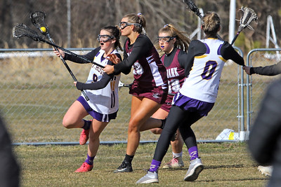 Anna Cahill (left) battles with Red Bank Regional defenders as St Rose High School girls varsity lacrosse takes on Red Bank Regional High School on Wednesday March 27, 2019 at the St Rose Sports Complex in Wall. (MARK R. SULLIVAN /THE COAST STAR)