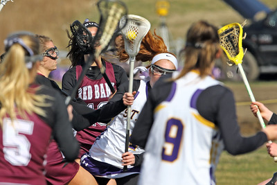 Olivia Stoddard (center) brings the ball up field as St Rose High School girls varsity lacrosse takes on Red Bank Regional High School on Wednesday March 27, 2019 at the St Rose Sports Complex in Wall. (MARK R. SULLIVAN /THE COAST STAR)