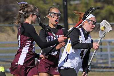 Olivia Stoddard (right) battles with Red Bank Regional defenders as St Rose High School girls varsity lacrosse takes on Red Bank Regional High School on Wednesday March 27, 2019 at the St Rose Sports Complex in Wall. (MARK R. SULLIVAN /THE COAST STAR)