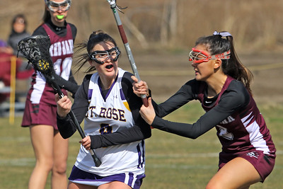 Anna Cahill (left) battles with a Red Bank Regional defender as St Rose High School girls varsity lacrosse takes on Red Bank Regional High School on Wednesday March 27, 2019 at the St Rose Sports Complex in Wall. (MARK R. SULLIVAN /THE COAST STAR)