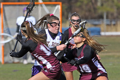 Avery Morgan (center) battles with Red Bank regional defenders as St Rose High School girls varsity lacrosse takes on Red Bank Regional High School on Wednesday March 27, 2019 at the St Rose Sports Complex in Wall. (MARK R. SULLIVAN /THE COAST STAR)