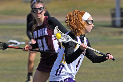 Olivia Stoddard (right) brings the ball up field as St Rose High School girls varsity lacrosse takes on Red Bank Regional High School on Wednesday March 27, 2019 at the St Rose Sports Complex in Wall. (MARK R. SULLIVAN /THE COAST STAR)