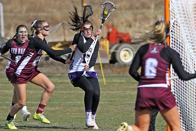 Avery Morgan (center) heads toward the Red Bank Regional goal as St Rose High School girls varsity lacrosse takes on Red Bank Regional High School on Wednesday March 27, 2019 at the St Rose Sports Complex in Wall. (MARK R. SULLIVAN /THE COAST STAR)