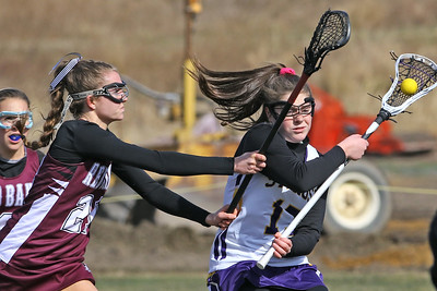 Avery Morgan (right) battles with Red Bank Regional defenders as St Rose High School girls varsity lacrosse takes on Red Bank Regional High School on Wednesday March 27, 2019 at the St Rose Sports Complex in Wall. (MARK R. SULLIVAN /THE COAST STAR)