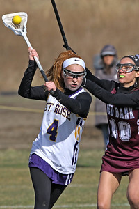 Olivia Stoddard (left) brings the ball up field as St Rose High School girls varsity lacrosse takes on Red Bank Regional High School on Wednesday March 27, 2019 at the St Rose Sports Complex in Wall. (MARK R. SULLIVAN /THE COAST STAR)