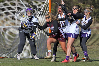 Goalie Allison Darcy (left)  waits for the ball as St Rose High School girls varsity lacrosse takes on Red Bank Regional High School on Wednesday March 27, 2019 at the St Rose Sports Complex in Wall. (MARK R. SULLIVAN /THE COAST STAR)
