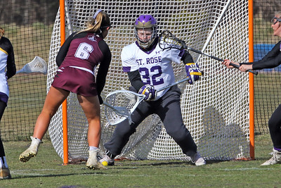Goalie Allison Darcy (right) blocks the ball as St Rose High School girls varsity lacrosse takes on Red Bank Regional High School on Wednesday March 27, 2019 at the St Rose Sports Complex in Wall. (MARK R. SULLIVAN /THE COAST STAR)