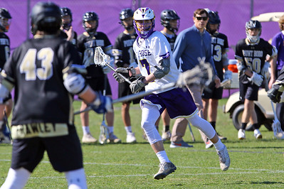 Logan LeMoult (center) from St Rose brings the ball up field as St. Rose High School hosted Point Pleasant Borough High School in a boys varsity lacrosse game held in Wall Township on Wednesday April 10, 2019. (MARK R, SULLIVAN/THE COAST STAR)