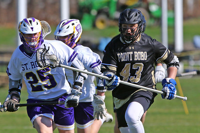 Patrick Frawley of Boro battles his way past St Rose defenders as St. Rose High School hosted Point Pleasant Borough High School in a boys varsity lacrosse game held in Wall Township on Wednesday April 10, 2019. (MARK R, SULLIVAN/THE COAST STAR)