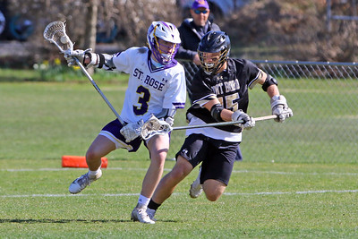 Patrick Dwyer (left) of St Rose battles with Scott Franceshini of Boro as St. Rose High School hosted Point Pleasant Borough High School in a boys varsity lacrosse game held in Wall Township on Wednesday April 10, 2019. (MARK R, SULLIVAN/THE COAST STAR)