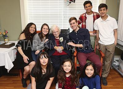 wall Kathleen Farrell 100th birthday  Kathleen ( Center)  with her  great grandchildren.