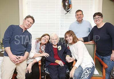 wall Kathleen Farrell 100th birthday  Kathleen ( Center)  with her grandchildren. Rob Hammond. Sharon Clarke. Ellen Moe. Doug Hammond and Michelle Hammond