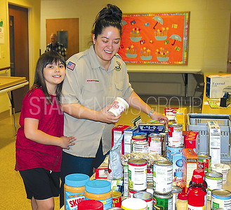Manasquan Food drive at First Presbyterian 5/6/2017 from L to R: Jacqueline Porcello age 9 and Theresa Porcello both of Brielle