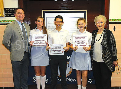 """Spring Lake Poetry award ceremony 5/5/2017 from L to R: Principal Robert Dougherty, 3rd prize """" Hailey Hathaway, Gr.7, lst prize Anthony Canzoneri, Gr.7, 2nd prize """" Erin Paniscotti, Gr.8, Nikki Manno, Catholic Daughters of America poetry chairperson"""
