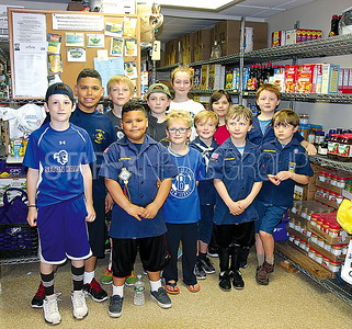 Manasquan Food drive at First Presbyterian 5/6/2017: Cubscouts Pack 63 in food pantry of First Presbyterian