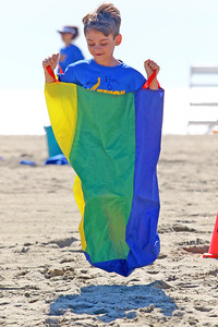 Kindergartner Sean Kinkela leaps along during the sack race as Avon Elementary School students enjoyed the at Norwood Ave beach in Avon -by-the-Sea during their annual Field day On Friday June 14, 2019. (MARK R. SULLIVAN /THE COAST STAR)