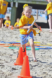 Addie Hayes races toward the  finish line during the really race as Avon Elementary School students enjoyed the at Norwood Ave beach in Avon -by-the-Sea during their annual Field day On Friday June 14, 2019. (MARK R. SULLIVAN /THE COAST STAR)