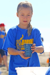 Ava Looney keeps her water cup steady during the water race as Avon Elementary School students enjoyed the at Norwood Ave beach in Avon -by-the-Sea during their annual Field day On Friday June 14, 2019. (MARK R. SULLIVAN /THE COAST STAR)