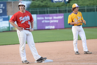 Wall High School Varsity Pitcher Spencer Bauer advancing to 3rd base as opposing team 3rd baseman of St. Rose, Frank Belleza waits for the next batter, at the 2019 Shore Conference All-Star Game on 06/12/2019. (STEVE WEXLER/THE COAST STAR).