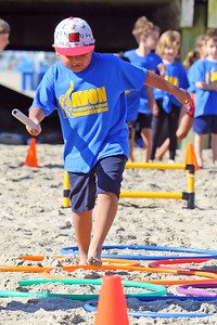 Lucas Valdes makes his way though the hoops during the relay race as Avon Elementary School students enjoyed the at Norwood Ave beach in Avon -by-the-Sea during their annual Field day On Friday June 14, 2019. (MARK R. SULLIVAN /THE COAST STAR)